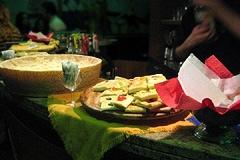 Half-wheel of Parmigiano and focaccia slices.